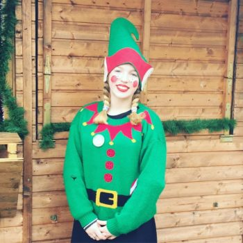 Father Christmas: A cheery elf at Santa's Woodland Grotto, Upton Country Park, Poole